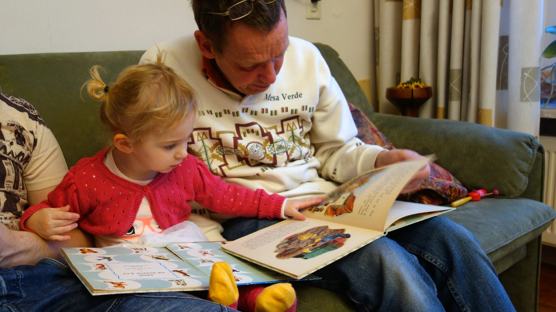 Dad Reading With a Toddler