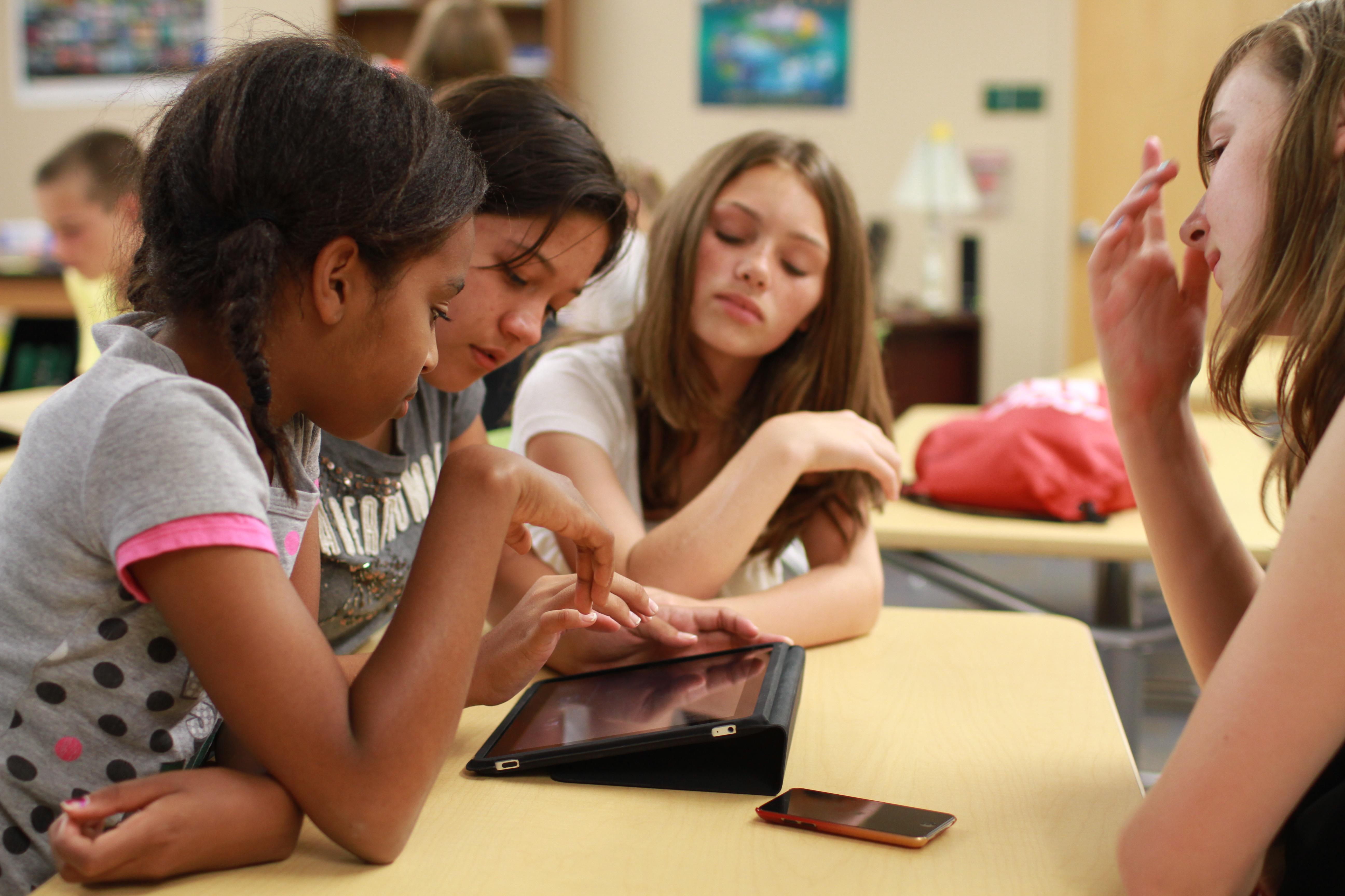 Girls learning using an iPad